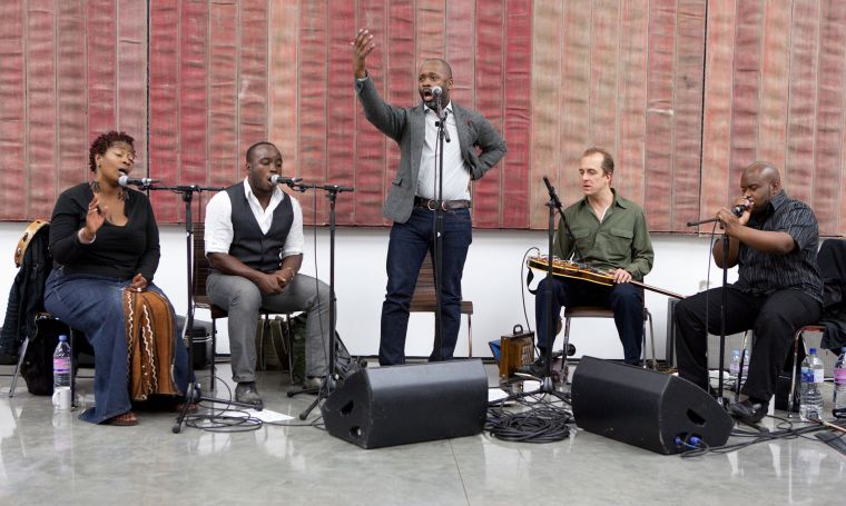 Theaster Gates is in the middle of the photo.